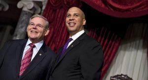 Sen. Cory Booker, D-N.J., right, stands with Sen. Robert Menendez, D-N.J., following re-enactment swearing ceremony, Thursday, Oct. 31, 2103, on  Capitol Hill in Washington. (AP Photo/J. Scott Applewhite)